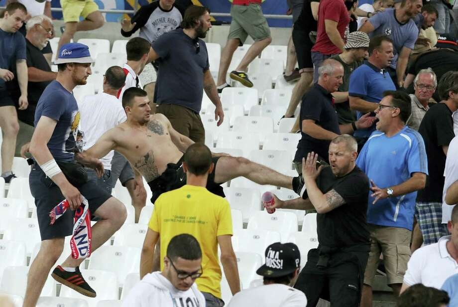 Clashes break out in the stands after the Euro 2016 Group B soccer match between England and Russia, at the Velodrome stadium in Marseille, France, Saturday, June 11, 2016.  AP Photo — Thanassis Stavrakis Photo: AP / AP
