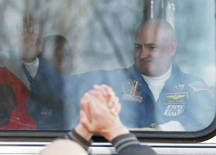 U.S. astronaut Scott Kelly crew member of the mission to the International Space Station, ISS, waves to his relatives from a bus prior the launch of Soyuz-FG  rocket at the Russian leased Baikonur cosmodrome, Kazakhstan, Friday, March 27, 2015.  (AP Photo/Dmitry Lovetsky) Photo: AP / AP