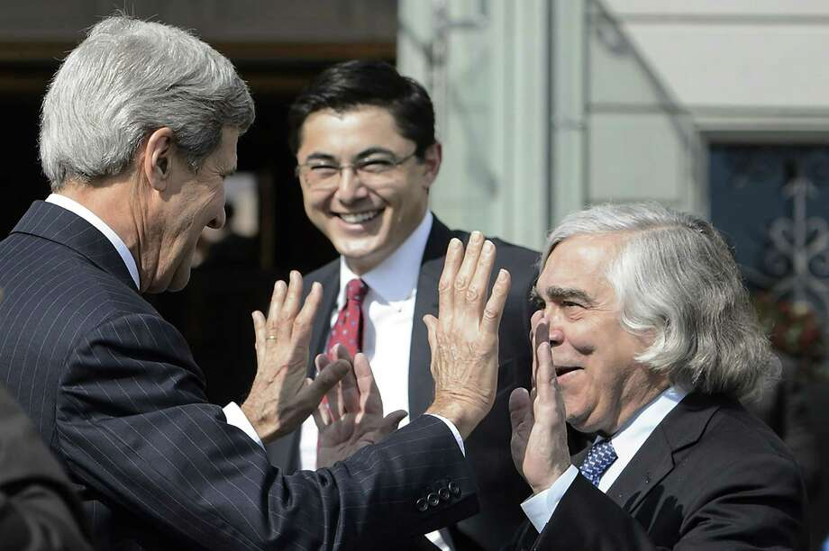 U.S. Secretary of State John Kerry, left, jokes with Ernest Moniz, US Secretary of Energy, right, as they walk outside the hotel during a break from a bilateral meeting with Iranian Foreign Minister Mohammad Javad Zarif  for a new round of Nuclear Iran Talks, in Lausanne, Switzerland, Friday, March 27, 2015. (AP Photo/Keystone,Jean-Christophe Bott) Photo: AP / KEYSTONE