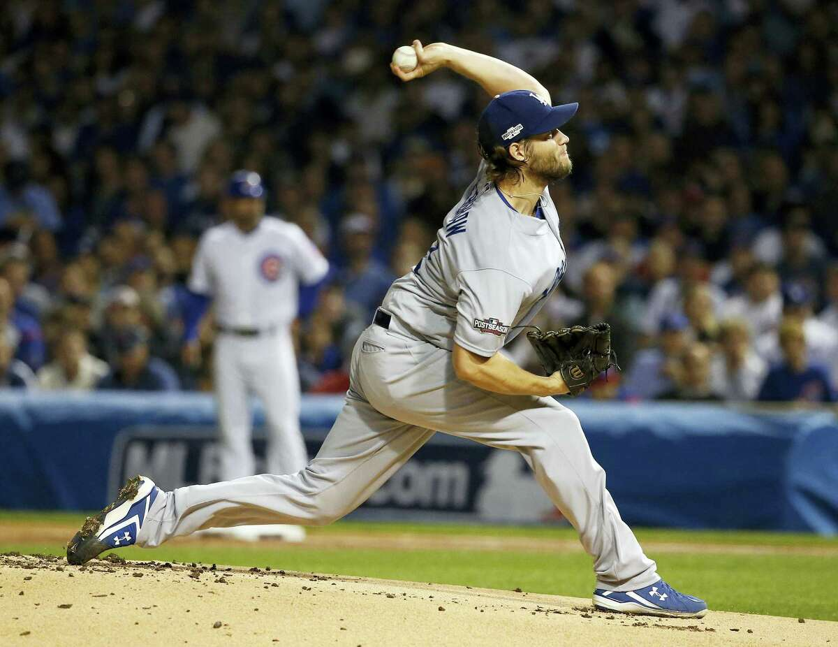 Dodgers starting pitcher Clayton Kershaw throws during Game 2 of the NLCS on Sunday in Chicago.