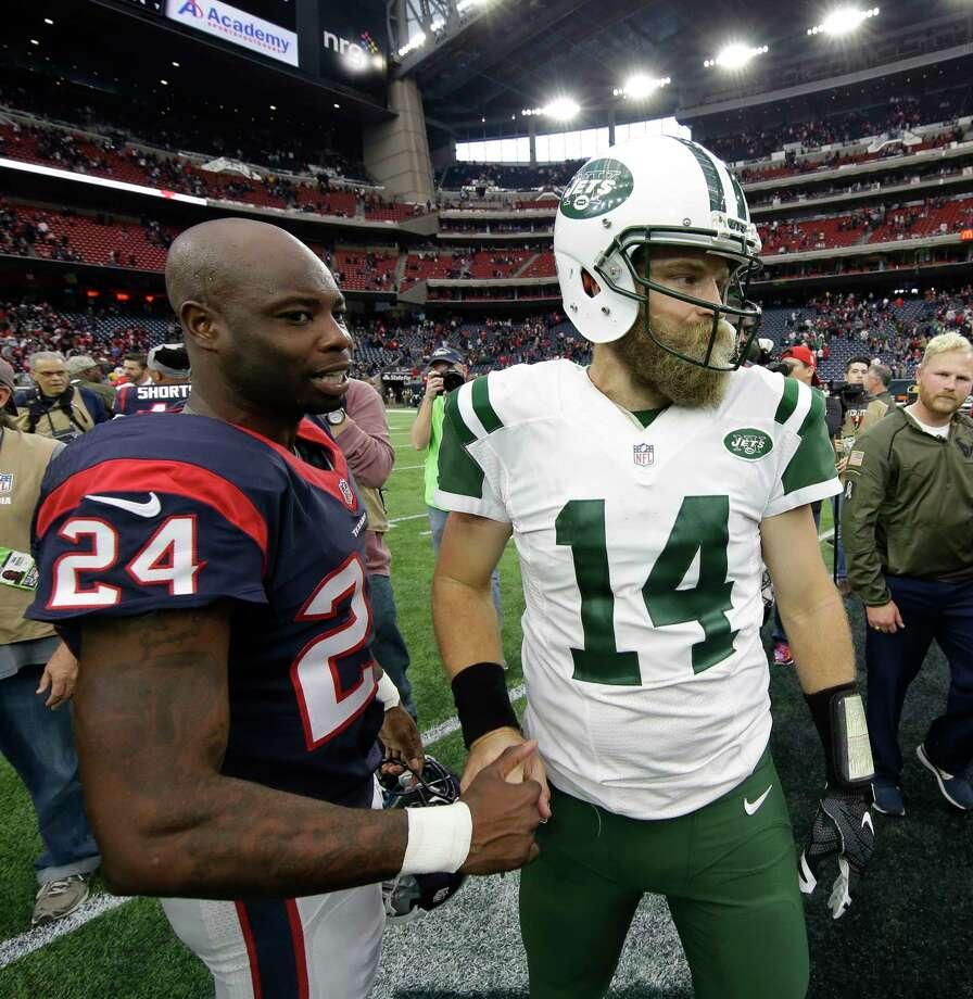 Houston Texans cornerback Johnathan Joseph and New York Jets quarterback Ryan Fitzpatrick meet on the field following Sunday's game. Photo: David J. Phillip — The Associated Press  / AP