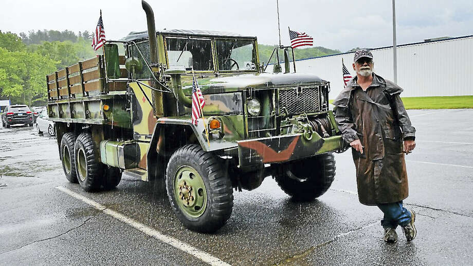 Scott Pare of Winsted exhibited his 1970 M35 A2 Kaiser, a vintage U.S. Army cargo truck, at Saturday's Memorial Show for Zak Dube, a 23-year-old Torrington resident who died in a vehicle accident in May. Photo: N.F. Ambery - The Register Citizen