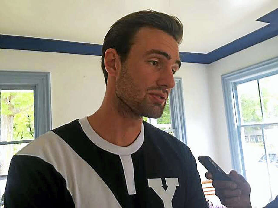 Yale senior Hubert Trzybinski talks to reporters at the Yale-Harvard Regatta's media day on Wednesday. Photo: David Borges — Register