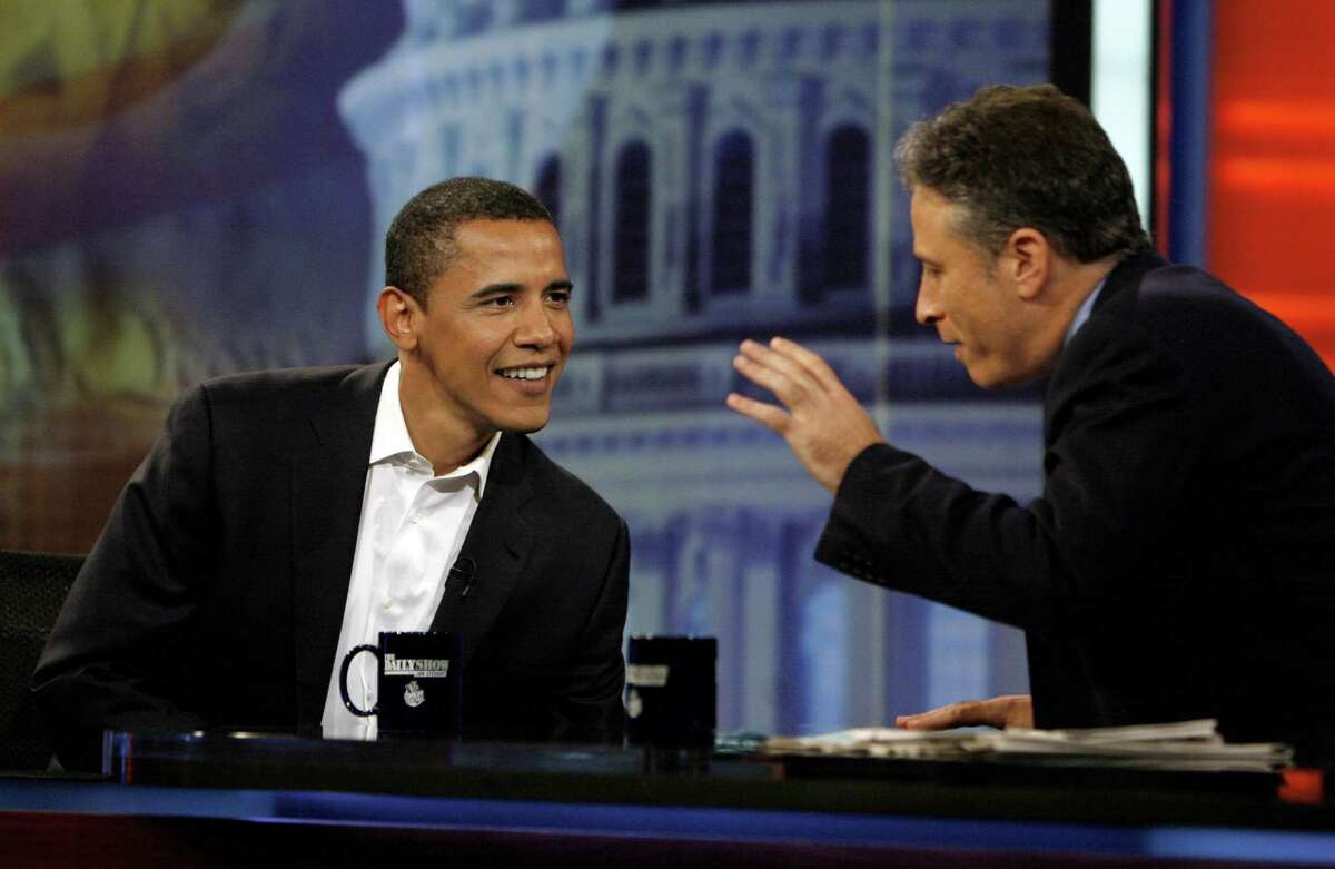 """In this Aug. 22, 2007 photo, then-Democratic presidential candidate U.S. Sen Barack Obama, D-Ill., talks with host Jon Stewart during an appearance on Comedy Central's """"The Daily Show with Jon Stewart"""" in New York. After more than 16 years and nearly 2,600 telecasts, Stewart will end his show on Aug. 6."""