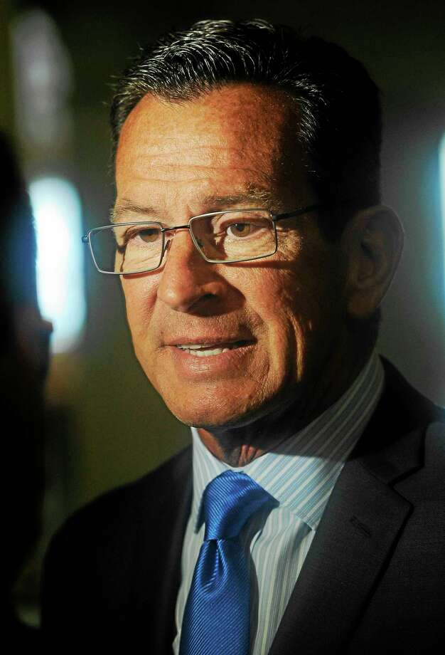 In this June 30 file photo, Gov. Dannel P. Malloy speaks to the media after signing the budget. Photo: Associated Press  / FR125654 AP