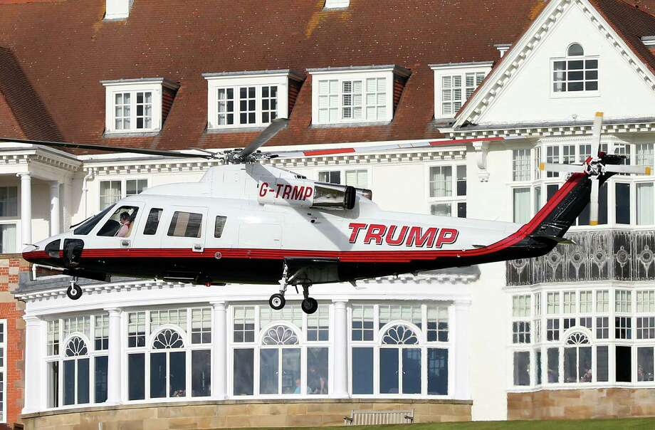 A helicopter owned by Donald Trump departs from the Turnberry golf course in Turnberry, Scotland, on Wednesday. Photo: Scott Heppell — The Associated Press  / AP