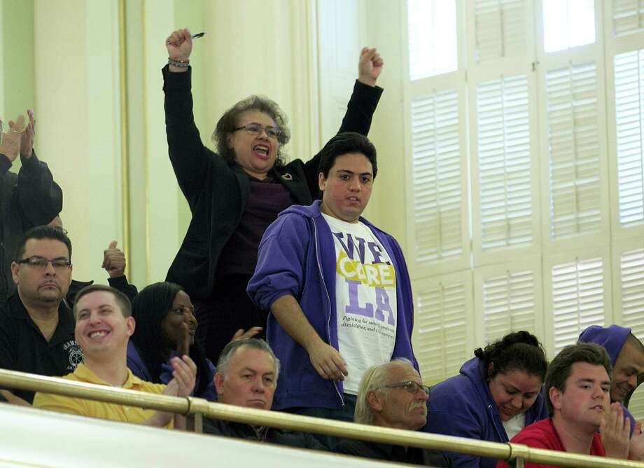 Supporters of a bill to raise California's minimum wage, celebrate in the Assembly gallery after the measure was approved by the state Assembly Thursday, March 31, 2016, in Sacramento, Calif. The proposal now moves on to the state Senate for consideration. Photo: AP Photo — Rich Pedroncelli / Copyright 2016 The Associated Press. All rights reserved. This material may not be published, broadcast, rewritten or redistributed without permission.