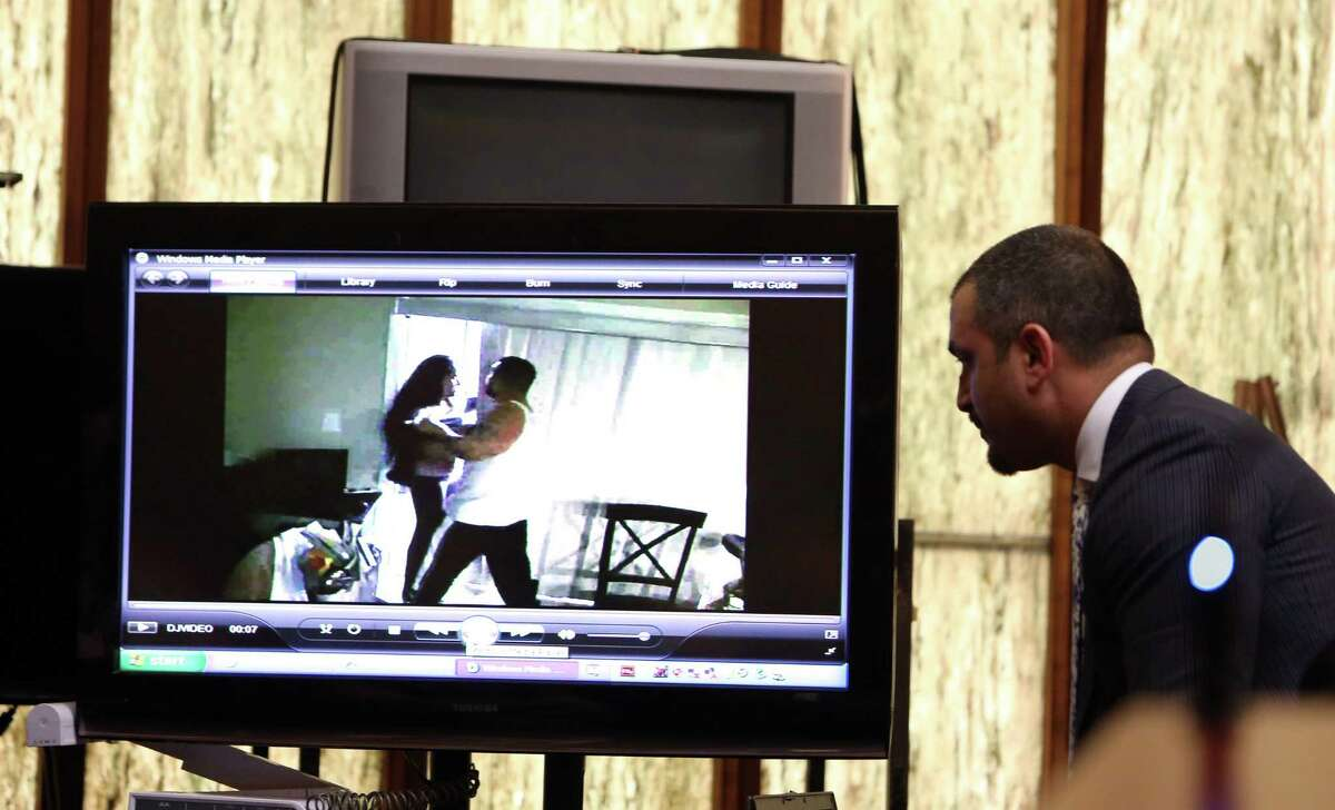 Defense attorney Saam Zangeneh, right, looks at a 2012 or earlier video of the murder victim Jennifer Alfonso and defendant Derek Medina, making contact in a home surveillance video during day five of Medina's murder trial Tuesday, Nov. 17, 2015 in Miami. He is accused of murdering his wife in August 2013 and then posting a photo of her body on Facebook. He claims self defense. (Walter Michot/Miami Herald via AP, Pool)