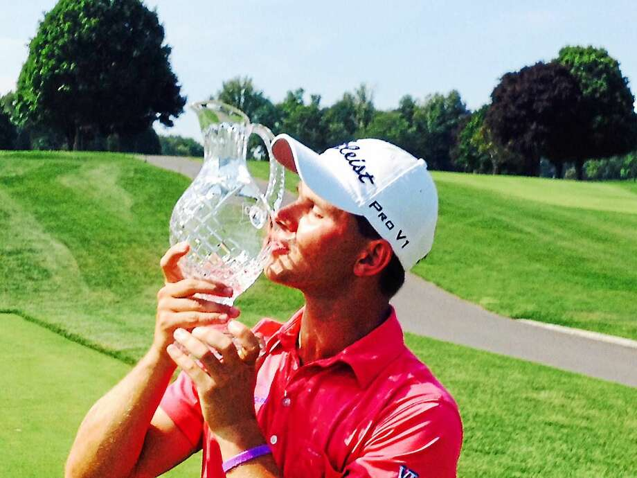 Cody Paladino kisses the crystal following his two-stroke win in the 81st Connecticut Open championship at The Patterson Club on Wednesday. Photo: Joe Morelli — Register