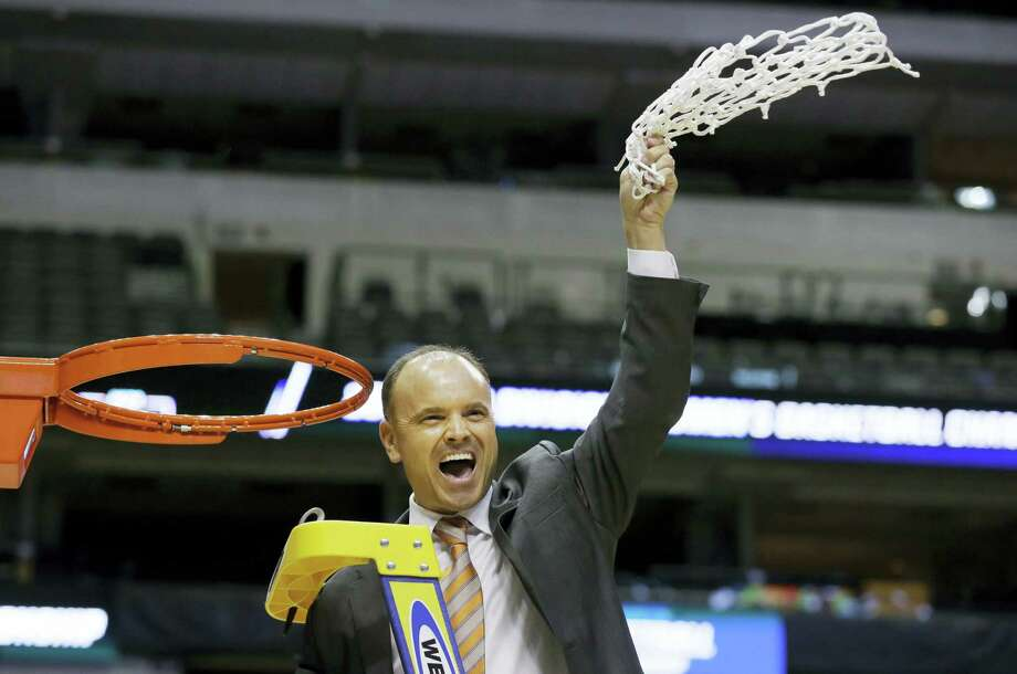 Oregon State head coach Scott Rueck waves the net after winning the regional final against Baylor Monday in Dallas. Oregon State won 60-57 and plays UConn Sunday. Photo: The Associated Press  / Copyright 2016 The Associated Press. All rights reserved. This material may not be published, broadcast, rewritten or redistributed without permission.