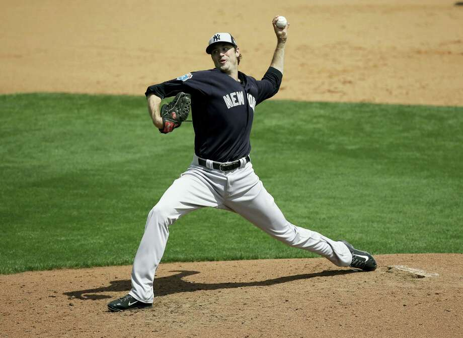 New York Yankees pitcher Andrew Miller pitches against the Atlanta Braves in a spring training baseball game, Wednesday, March 30, 2016, in Kissimmee, Fla.  He his hit by a batted ball on the pitch. (AP Photo/John Raoux) Photo: AP / AP