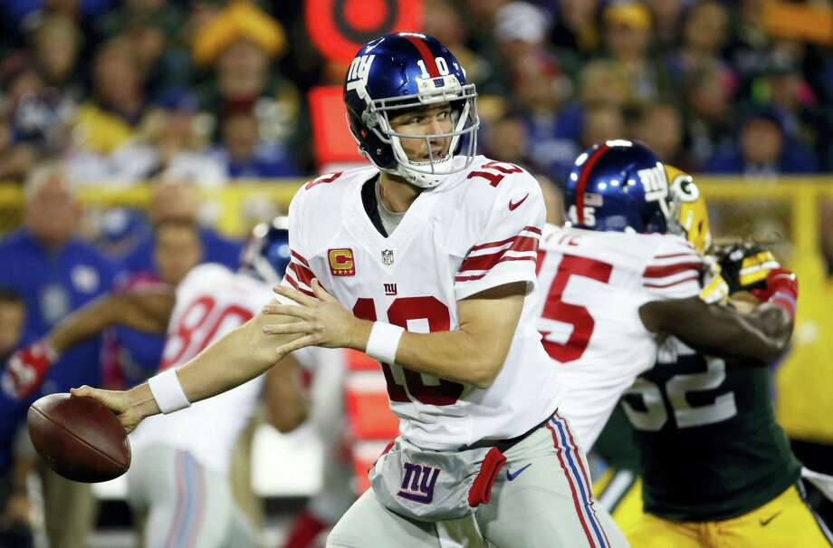 New York Giants' Eli Manning throws during the first half last week's game against the Packers. Photo: The Associated Press File Photo  / FR155603 AP