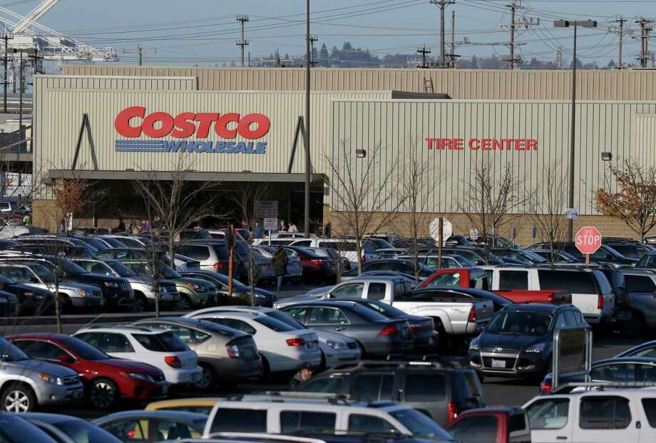 Cars fill the parking lot of a Costco store Nov. 24, 2015 in Seattle. Health authorities say chicken salad from Costco has been linked to at least one case of E. coli in Washington state. Photo: AP Photo/Ted S. Warren  / AP