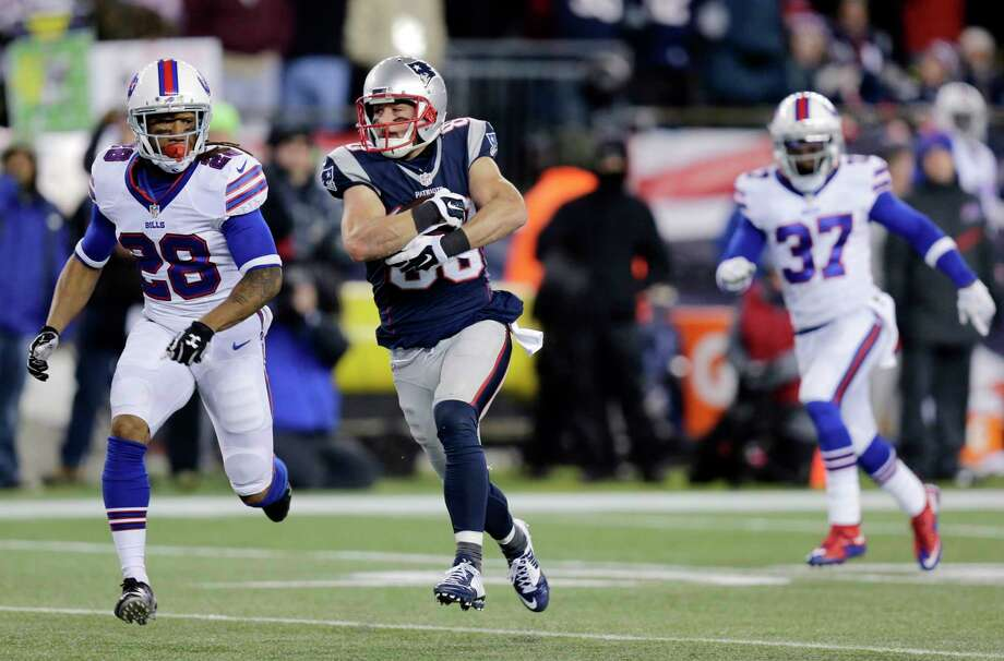 Patriots wide receiver Danny Amendola (80) runs from Bills defensive backs Ronald Darby (28) and Nickell Robey (37) after catching a pass in the second half on Monday. Photo: Charles Krupa — The Associated Press  / AP