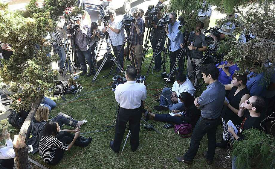 Vallejo Police Lt. Kenny Park, center, speaks Wednesday to reporters about the reported abduction and ransom of Denise Huskins in Vallejo, Calif. Photo: (AP Photo/Vallejo Times-Herald, Chris Riley) / Vallejo Times-Herald
