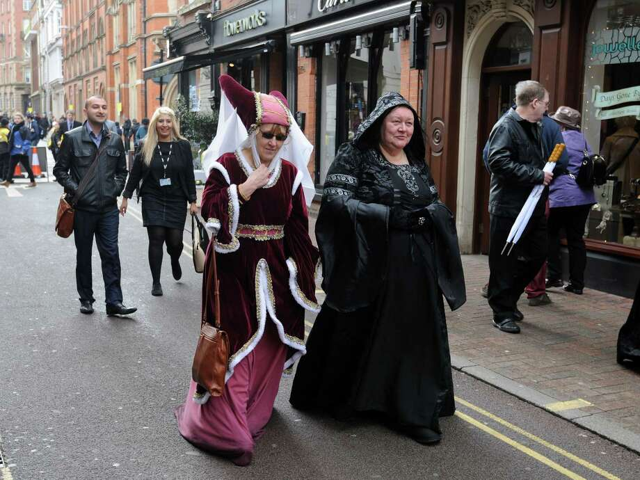 Two members of the public in traditional dress after attending a service for the re-reinterment of the mortal remains of King Richard III at Leicester Cathedral, Leicester, England, Thursday, March 26, 2015. The skeleton of King Richard III was discovered in 2012 500 years after he was killed in the Battle of Bosworth Field. (AP Photo/Rui Vieira) Photo: AP / AP