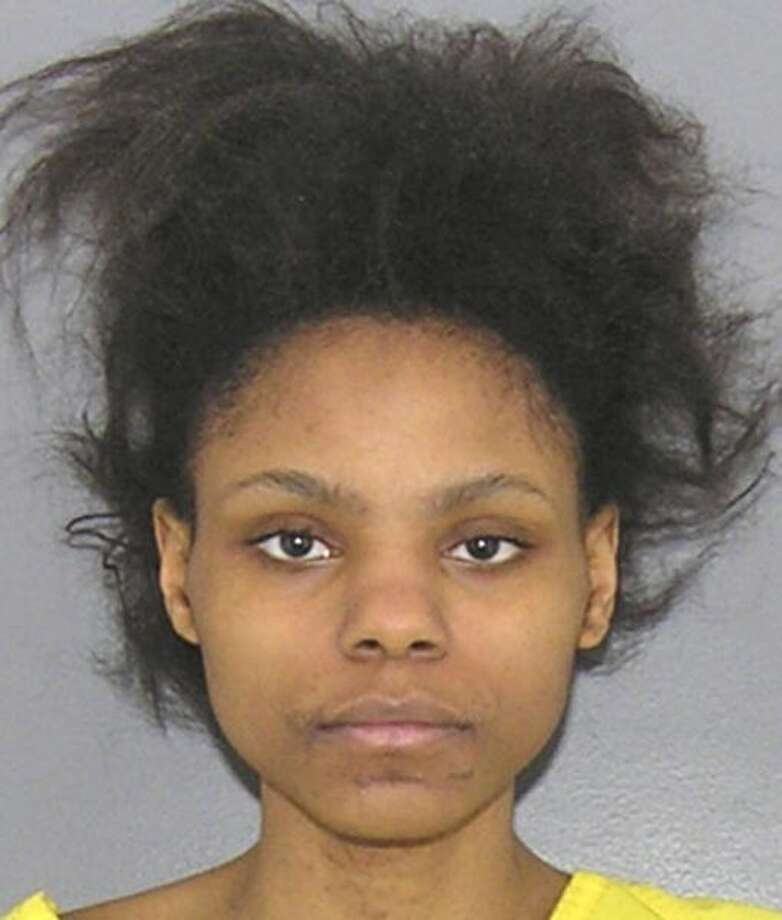 FILE - This booking photo provided by the Hamilton County, Ohio Sheriff shows Deasia Watkins in Cincinnati. Accused of decapitating her 3-month-old daughter with a chef's knife, Watkins was indicted Wednesday, March 25, 2015 on a charge of aggravated murder. (AP Photo/Hamilton County Sheriff) Photo: AP / Hamilton County Sheriff