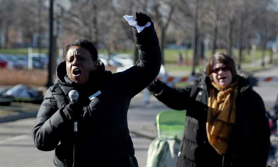 Grace Jones, of the AFSCME union, chants along with the crowd of union workers and protesters before speaking in front of a police precinct Saturday, Nov. 21, 2015, in Minneapolis. Photo: Kyndell Harkness/Star Tribune Via AP  / Star Tribune