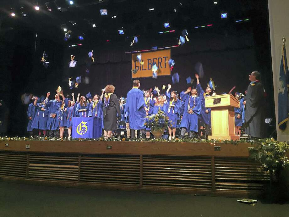 Ben Lambert - The Register CitizenThe Gilbert School Class of 2016 throws their caps in the air, after officially being declared graduates of the institution Friday. Photo: Journal Register Co.