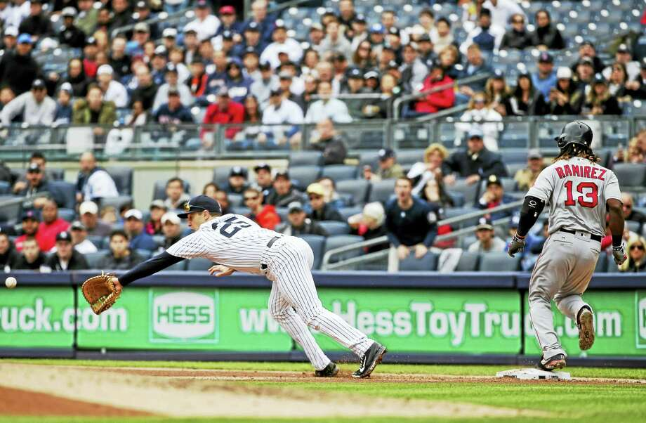 New York Yankees first baseman Mark Teixeira (25) dives for a ball thrown by third baseman Chase Headley for an error as Boston Red Sox's Hanley Ramirez (13) is safe at first base during the fourth inning of a baseball game on May 7, 2016 in New York. Ramirez advanced to second base on the play. Photo: AP Photo/Frank Franklin II  / Copyright 2016 The Associated Press. All rights reserved. This material may not be published, broadcast, rewritten or redistribu