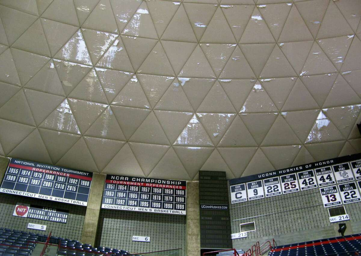 Numerous frayed panels hang in Gampel Pavilion, the University of Connecticut's basketball arena, Wednesday, March 30, 2016, in Storrs. The school's board of trustees approved plans to spend $10 million to refurbish the arena's aging roof, with work scheduled to be completed in October.