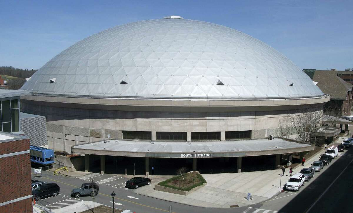 Gampel Pavilion stands on the University of Connecticut campus Wednesday, March 30, 2016, in Storrs. The school's board of trustees approved plans to spend $10 million to refurbish the basketball arena's aging roof, with work scheduled to be completed in October.