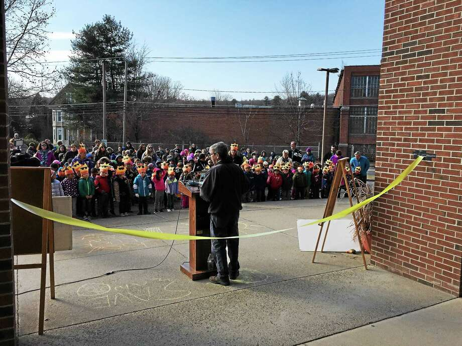 The Forbes School community gathered Tuesday to dedicate newly activated solar panels that have been installed on the school roof. Photo: BEN LAMBERT — The Register Citizen