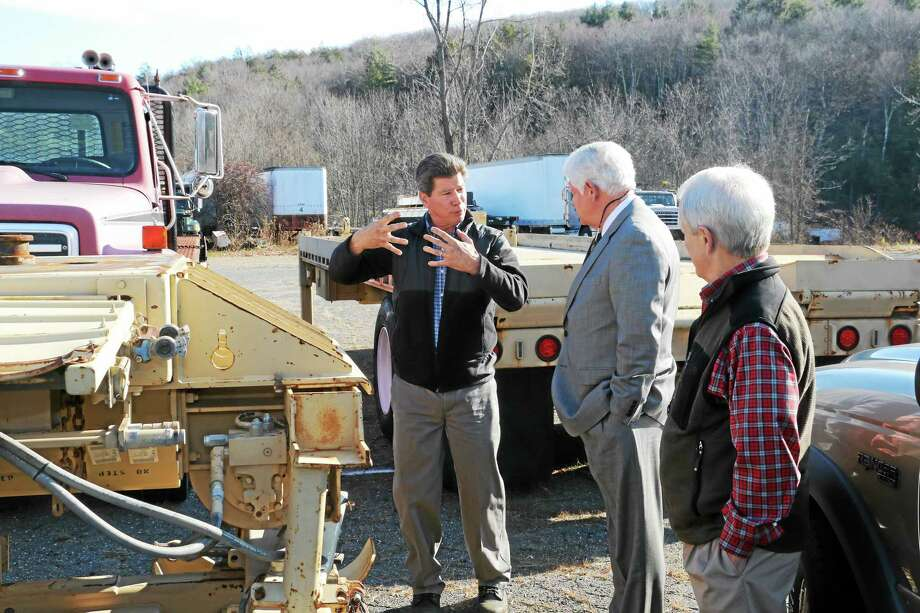 Martin Marola, president of Tru-Hitch, talks to U.S. Rep. John Larson and First Selectman Don Stein about the company's plans to get a repairer's license so it can refurbish its military vehicles, which see heavy use in Afghanistan and elsewhere. Photo: John Fitts — The Register Citizen