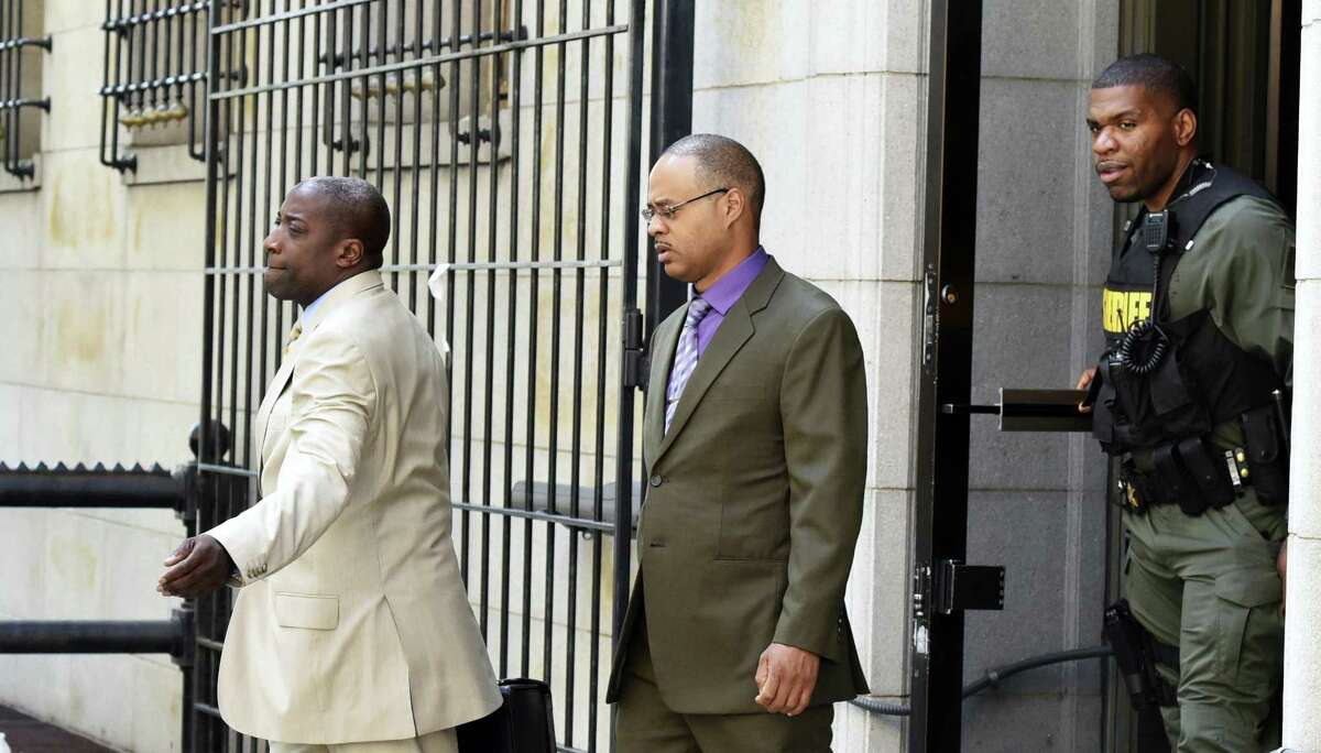 Baltimore Police Officer Caesar Goodson, center, leaves Courthouse East with his lawyer Matthew Fraling on Monday, June 6, 2016, in Baltimore. Caesar Goodson, who was driving the transport wagon, faces second-degree murder, manslaughter, assault, misconduct in office and reckless endangerment charges in the death of Freddie Gray.