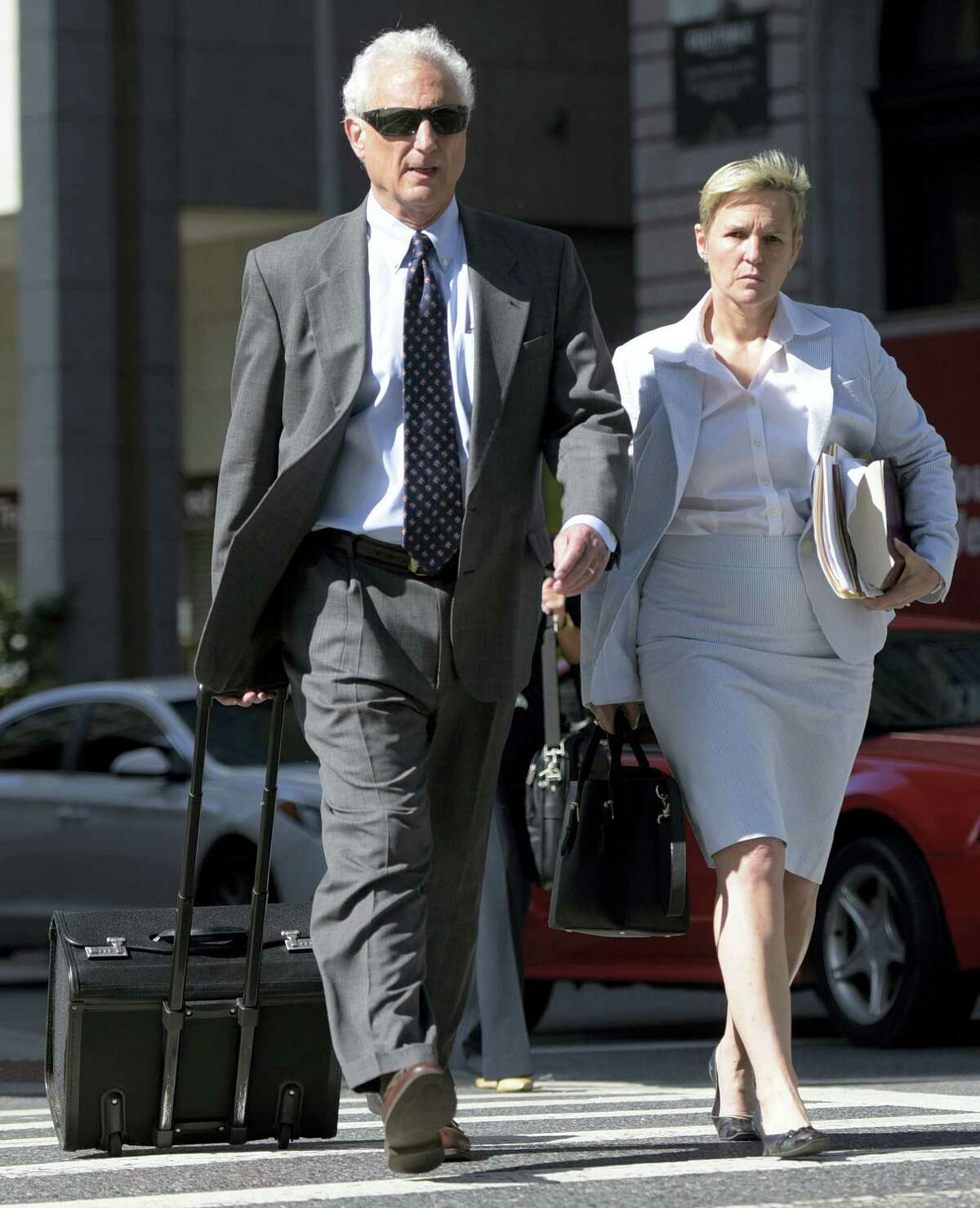 Chief Deputy State's Attorney Michael Schatzow, left, and Deputy State's Attorney Janice Bledsoe arrive for the first day of the trial of Officer Caesar Goodson, not pictured, charged with murder in the death of Freddie Gray, Thursday, June 9, 2016. Goodson, the driver of the transport wagon that carried Gray after his arrest, faces second-degree murder, manslaughter and other charges.