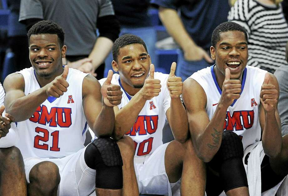 SMU players react late in the second half of their 62-54 victory over UConn in the final of the American Athletic Conference tournament. Photo: Fred Beckham — The Associated Press File Photo  / FR153656 AP