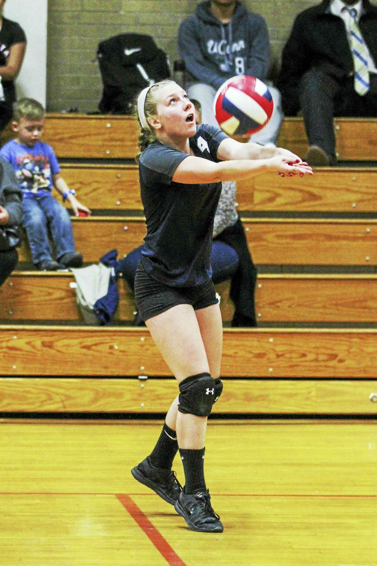 Wolcott Tech sophomore setter Katie Benedict kept her focus through 30 assists in Friday's three-game sweep over Kaynor Tech.