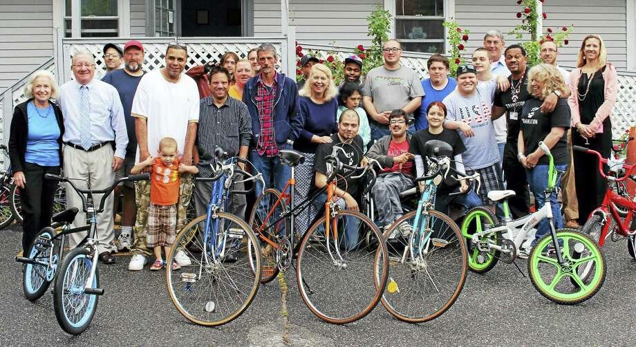 Contributed photo - LARC, Torrington Students in LARC's School to Community Transition Program donated 21 refurbished bicycles to residents living at FISH/Friends in Service to Humanity of Northwest Connecticut, on June 3. Photo: Journal Register Co.