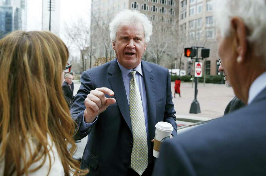 General Electric chairman and CEO Jeffrey Immelt, center, leaves the Boston Harbor Hotel after speaking at the Boston College Chief Executives Club on March 24, 2016. Photo: AP Photo/Michael Dwyer  / AP