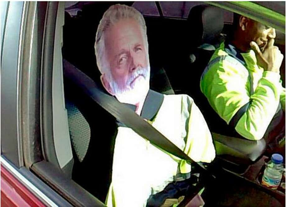 """This Monday photo by Washington State Patrol Trooper Tony Brock shows a cardboard cutout of the """"The Most Interesting Man In The World,"""" otherwise known as actor Jonathan Goldsmith, of Dos Equis beer TV commercial fame, strapped to the passenger seat next to a driver who tried to use the image to qualify to drive in the carpool lane on Interstate 5 near Fife, Wash. The trooper says it's by far the best carpool scam he's seen, but it didn't work. Both were chuckling as the driver, whose name wasn't released, said, """"He's my best friend."""" The State Patrol tweeted the photo, saying: """"I don't always violate the HOV lane law ... but when I do, I get a $124 ticket."""" Photo: (AP Photo/Washington State Patrol, Trooper Tony Brock) / Washington State Patrol"""