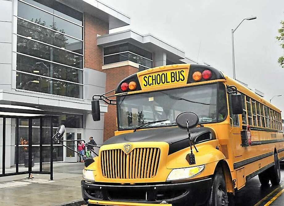 A school bus outside Roberto Clemente Leadership Academy in New Haven. Photo: New Haven Register File Photo