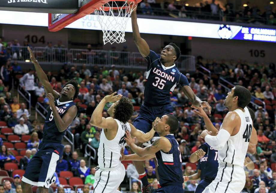 UConn's Amida Brimah, center, will be joining Daniel Hamilton in testing the NBA draft waters. Photo: The Associated Press File Photo  / Copyright 2016 The Associated Press. All rights reserved. This material may not be published, broadcast, rewritten or redistributed without permission.