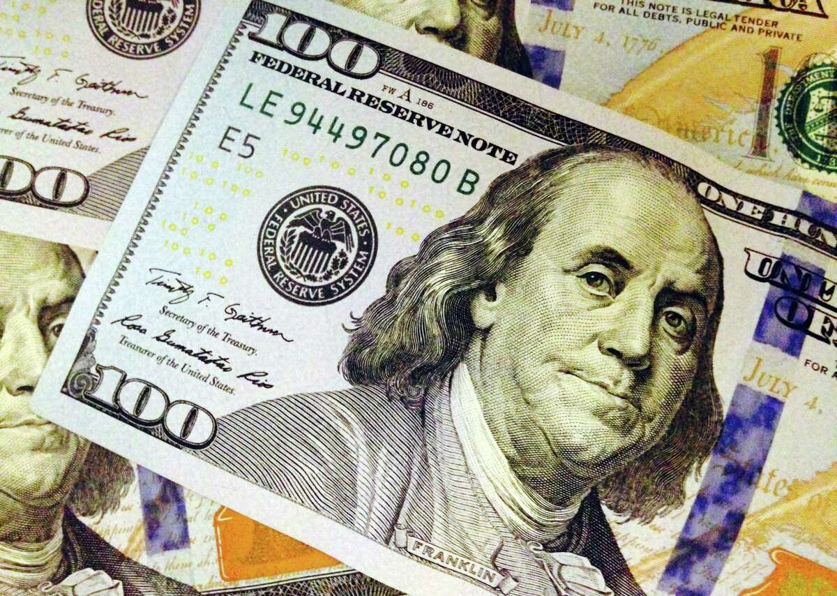 This Feb. 2, file photo, depicts a part of a U.S. $100 bill.