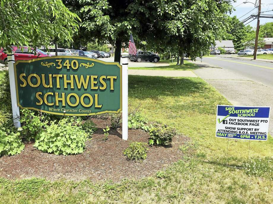 Ben Lambert - The Register Citizen  Signs seen outside of Southwest School last week. The Torrington Board of Education voted against closing the institution after the current school year Wednesday. Photo: Journal Register Co.