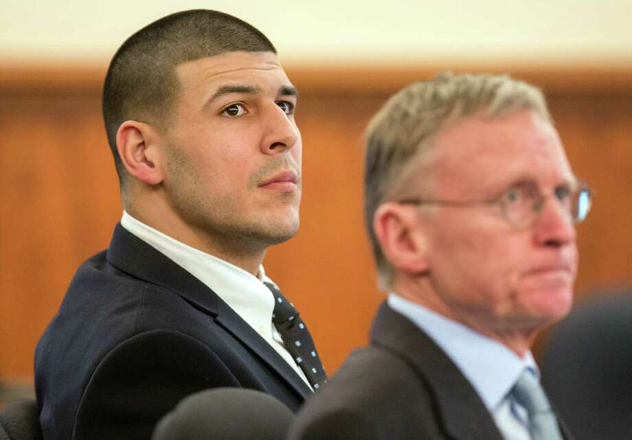Former New England Patriots NFL football player Aaron Hernandez, left, sits beside his lawyer Charles Rankin during his murder trial at Bristol County Superior Court, Tuesday, March 24, 2015, in Fall River, Mass. Hernandez is charged with killing semiprofessional football player Odin Lloyd in June 2013. Photo: (AP Photo/The Boston Globe, Aram Boghosian, Pool) / Pool The Boston Globe