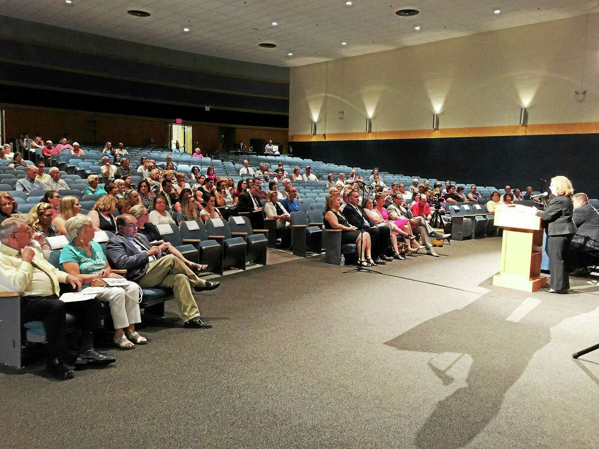 State Commissioner of Education Dianna Wentzell discusses the impending appointment of a receiver with local residents at The Gilbert School in Winsted.
