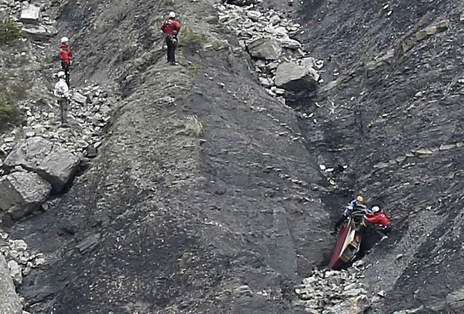 Rescue workers work on debris at the plane crash site near Seyne-les-Alpes, France, Wednesday, March 25, 2015, after a Germanwings jetliner crashed Tuesday in the French Alps. French investigators cracked open the badly damaged black box of a German jetliner on Wednesday and sealed off the rugged Alpine crash site where 150 people died when their plane on a flight from Barcelona, Spain to Duesseldorf, Germany, slammed into a mountain. Photo: (AP Photo/Laurent Cipriani) / AP
