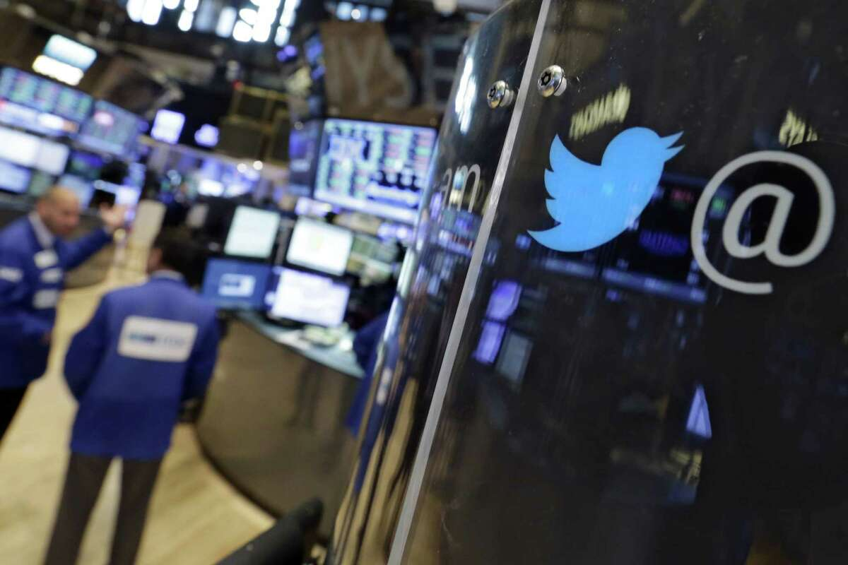 The logo for Twitter adorns a phone post on the floor of the New York Stock Exchange Tuesday. Twitter surprised investors with a strong earnings report even as the company searches for a permanent CEO and faces ongoing challenges growing its user base.