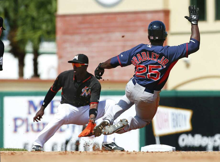 The Red Sox's Jackie Bradley Jr. slides into second base before getting tagged out by Miami Marlins shortstop Adeiny Hechavarria in Boston's spring training loss Tuesday in Jupiter, Fla. Photo: John Bazemore — The Associated Press  / AP