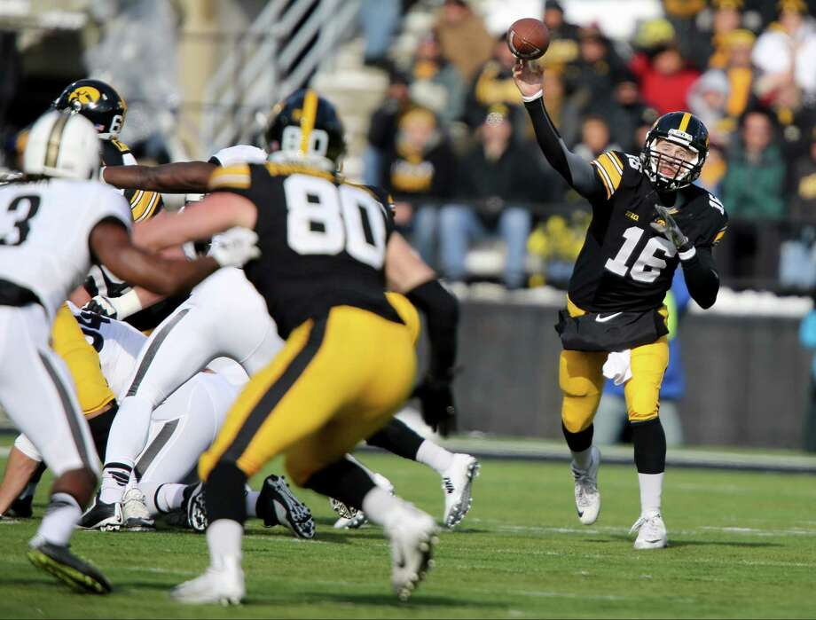 Iowa quarterback C.J. Beathard throws a pass during the first half Saturday against Purdue. Photo: Justin Hayworth — The Associated Press  / FR170760 AP