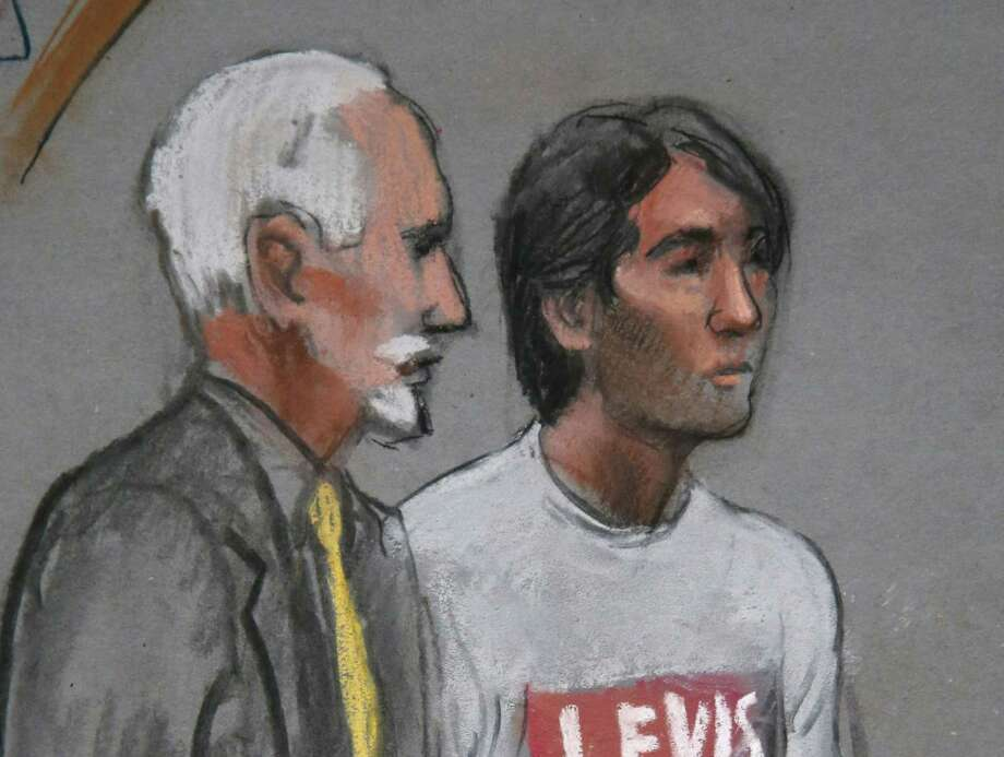 FILE - In this May 30, 2014 file courtroom sketch, Khairullozhon Matanov, right, stands with attorney Paul Glickman in federal court in Boston, facing obstruction of justice charges in the investigation of the Boston Marathon bombings. Matanov is scheduled to appear Tuesday, March 24, 2015, in federal court in Boston for a change of plea hearing. Photo: (AP Photo/Jane Flavell Collins, File) / Jane Flavell Collins