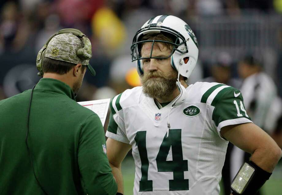 Jets quarterback Ryan Fitzpatrick talks on the sidelines during the second half of Sunday's game against the Texans. Photo: David J. Phillip — The Associated Press  / AP