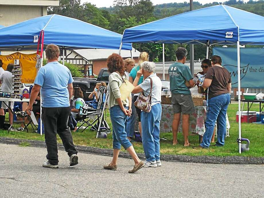 CALL FOR FARMERS, VENDORS, ARTISTS AND MUSICIANS FOR 2015 SEASON The Watertown Farmers' Market will open for its 8th season on July 11, 2015.  The Market, which operates out of the Libray Parking lot at 470 Main Street in Watertown on Saturdays from 9am - 1pm, begining July 11th through October 10th, is a Certified Producers Only Market through the State of Connecticut, Departmet of Agrculture.  This provides customers with the comfort that not only is the produce Connecticut Grown, it is grown locally by the person selling it.  Currently, we are accepting applications for the 2015 season for farmers, bakeries, cheese makers, specialty food vendors, and artisans.  Please note there ar no commercial vendors permitted, this includes: third party and indirect sales - everything must be grown, produced or handcrafted by the person selling.  Additionally, each week we feature a visiting artist and visiting musician, so we are scheduling those spots also at this time.  The Waterown Farmers' Market is well attended and has become a weekly destination spot for families and the local community. If you are interested in participating, please contact Doreen Breen, Market Manager at email: breen@watertownct.org or call 860-945-5246 Photo: Journal Register Co.