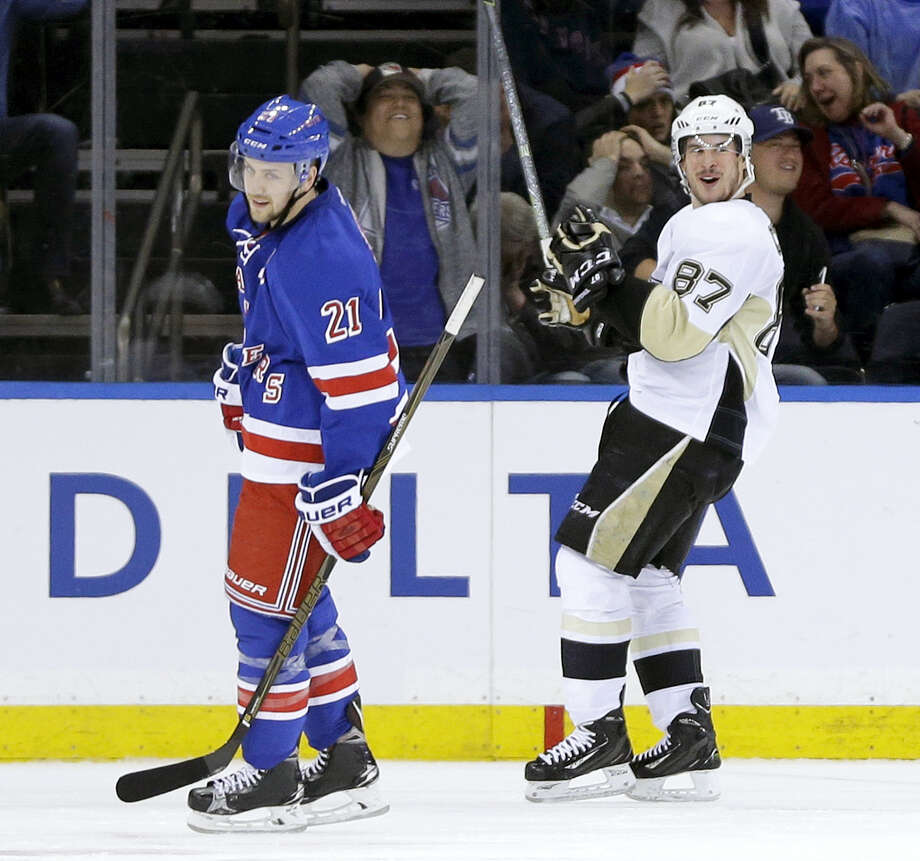 Pittsburgh Penguins' Sidney Crosby, right, and New York Rangers' Derek Stepan react after Crosby scored the game winning goal during the overtime period Sunday in New York. The Penguins defeated the Rangers 3-2. Photo: The Associated Press  / Copyright 2016 The Associated Press. All rights reserved. This material may not be published, broadcast, rewritten or redistributed without permission.