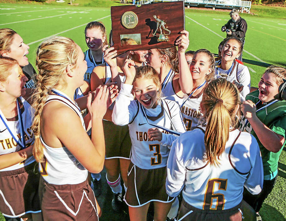 Thomaston  Golden Bears celebrate their 2-1 win over The Haddam-Killingworth Courgars 2-1 to claim the CIAC Class S Field Hockey crown at Weathersfield High School Saturday-John Vanacore/New Haven Register Photo: Journal Register Co. / John Vanacore